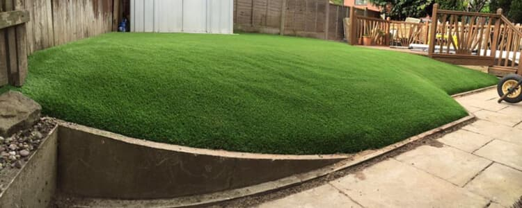 Artificial Turf Installed on Slope of Garden